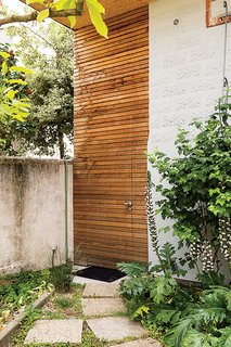 A cedar-clad door in the front provides a shortcut to the backyard.
