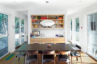 """""""You can get a really nice cross-breeze,"""" says Debbi Gibbs of her home, situated to capitalize on its lakefront parcel. """"If you open the sliding doors on both sides you really feel like the whole house is open."""""""