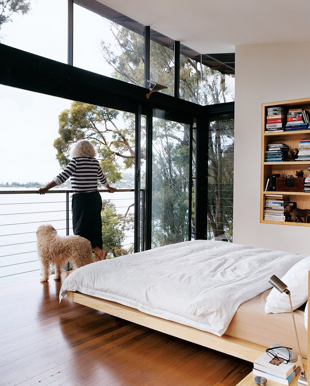 Bedroom, Bed, and Shelves Marcia takes in the view.  Photo 10 of 11 in Three Glass-and-Copper Pavilions Conquer the Cliffs