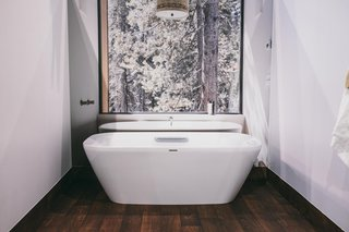 Finally, the bathroom holds a Neorest freestanding bathtub from TOTO. You can actually get inside the tub and pose for a photo in front of an image from the Huneeus/Sugar Bowl Home featured in the March 2015 issue.
