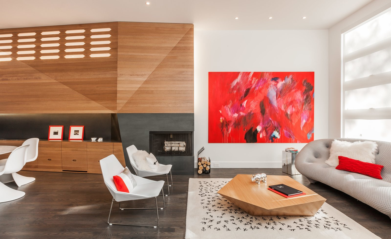 Living Room, Chair, Coffee Tables, Sofa, Recessed Lighting, Dark Hardwood Floor, Wood Burning Fireplace, and Standard Layout Fireplace The architects designed around another component of their 345 table in the refurnished living room, adding a Ploum sofa and a pair of Elsa armchairs from Ligne Roset.  Photo 15 of 17 in Four Floors of Gadgets and Gardens in Chicago