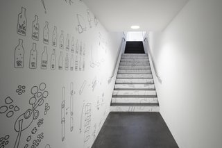 Oki Sato's sketches line a hallway and staircase in the museum.