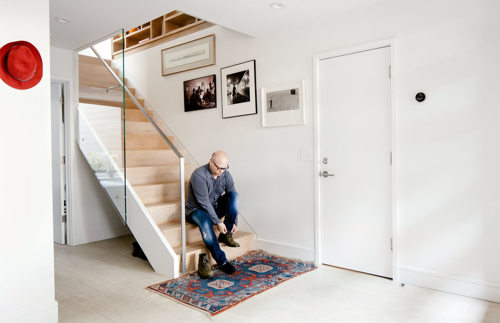 "Staircase, Metal Railing, and Wood Tread A glass panel was placed along the stair banister to create a transparent pathway for light to travel down from the second-floor skylight.  Photo 4 of 12 in Two Silicon Valley Vets Master the Smart Home Without Going Full ""Jetsons"""