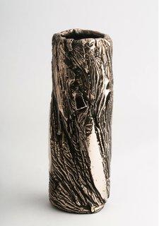 A slim bronze vessel.