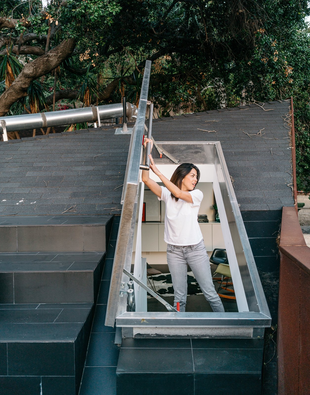 Windows, Skylight Window Type, and Metal Kristine climbs out onto the concrete-tile roof deck through a hatch door in the upstairs loft.  Photo 8 of 10 in This Los Angeles Home is Driven by Automotive Design