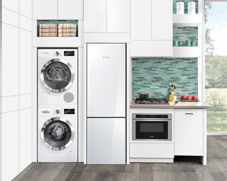"Coming this fall, the new Bosch 24"" kitchen appliances work particularly well in urban lofts and other small living situations, like guest suites. The new line, which includes gas and electric cooktops, will join their already-launched glass door refrigerator and laundry pairs."