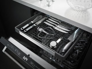In addition to the standard two levels of storage, the dishwasher has a third rack for odd-shaped items like cooking tools.