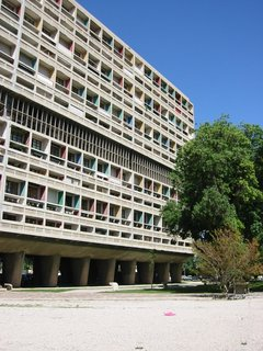 Unité d'Habitation de Marseilles is an example of the brise-soleil used by Le Corbusier. By setting the windows in a recessed grid, the building reduces heat gain. The colors indicate different apartment units.