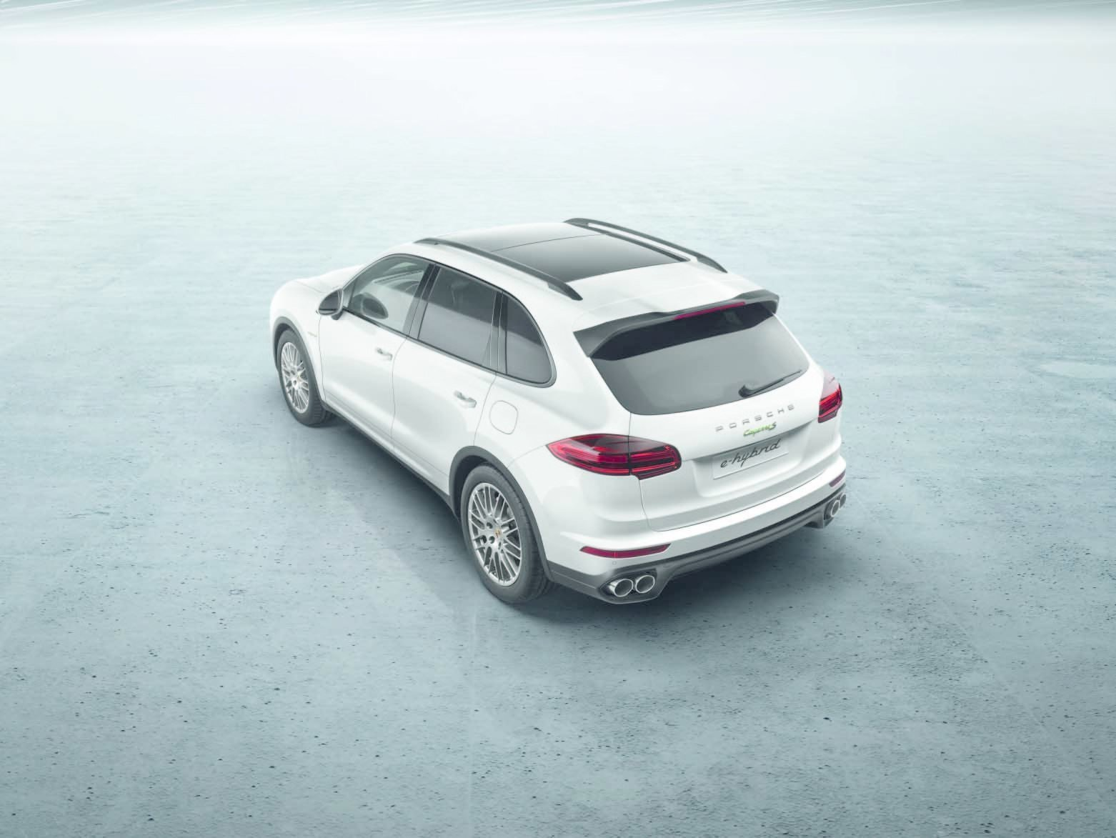 The most noticeable update to the Cayenne's form is the rear. The tailgate takes the shape of the rear lights, adding breadth to the vehicle.  Photo 3 of 8 in New Porsche Cayenne Editions Promise Greater Efficiency Without Compromising Performance
