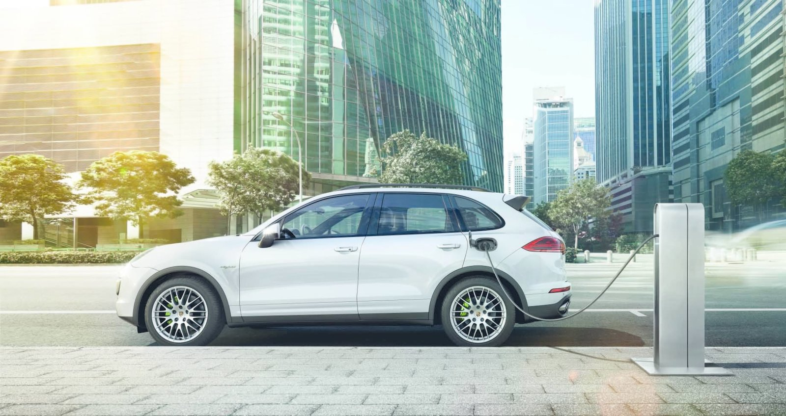 All four versions feature new fuel-saving functions, but the Cayenne S E-Hybrid take the gold when it comes to green. Capable of being driven on pure electric power, the trailblazing vehicle is the world's first plug-in hybrid luxury SUV.  Photo 6 of 8 in New Porsche Cayenne Editions Promise Greater Efficiency Without Compromising Performance
