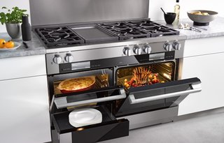 The Miele Range has three main components: an M Touch convection oven with a deep cavity for cooking large dishes, a smaller M Touch speed oven that can be used as a microwave or oven, and a warming drawer. The main oven on the range also gives the option to cook using steam, and a wireless roast probe is included to perfect meat cooking.
