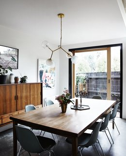 A Y chandelier by Douglas and Bec hangs above a vintage table and chairs.