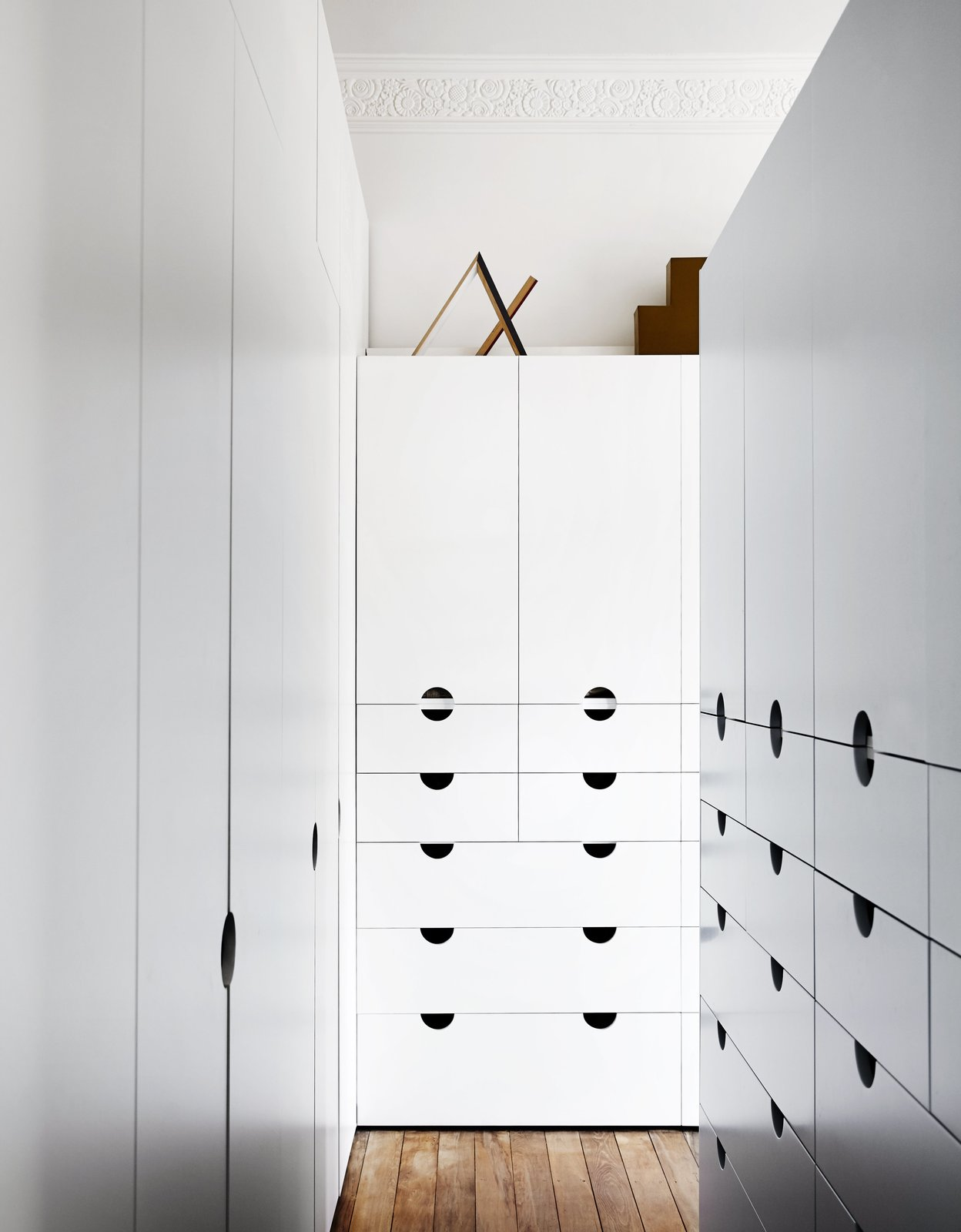 Hallway and Medium Hardwood Floor When an existing living room was transformed into a master suite, Nest tapped Mason Cabinets to create a bespoke dressing area.  Photo 10 of 13 in An Unassuming Edwardian Saves the Best for Out Back