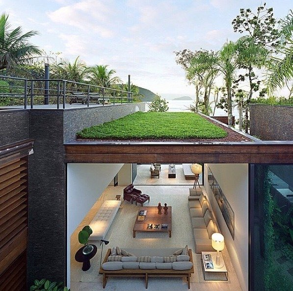 """Condomínio Baleia by Studio Arthur Casas in Sao Paolo, Brazil features a grass roof terrace with seaviews of Praia da Baleia beach."""