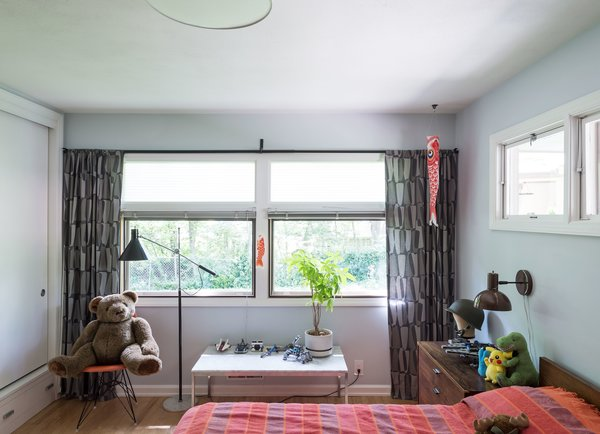 which is painted in Borrowed Light by Farrow and Ball. His bed is a George Nelson design for Herman Miller.