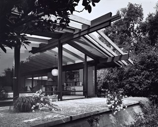 The architects maintained the midcentury post-and-beam construction and Japanese-inspired details of the original building, while brightening and expanding the interior living spaces.