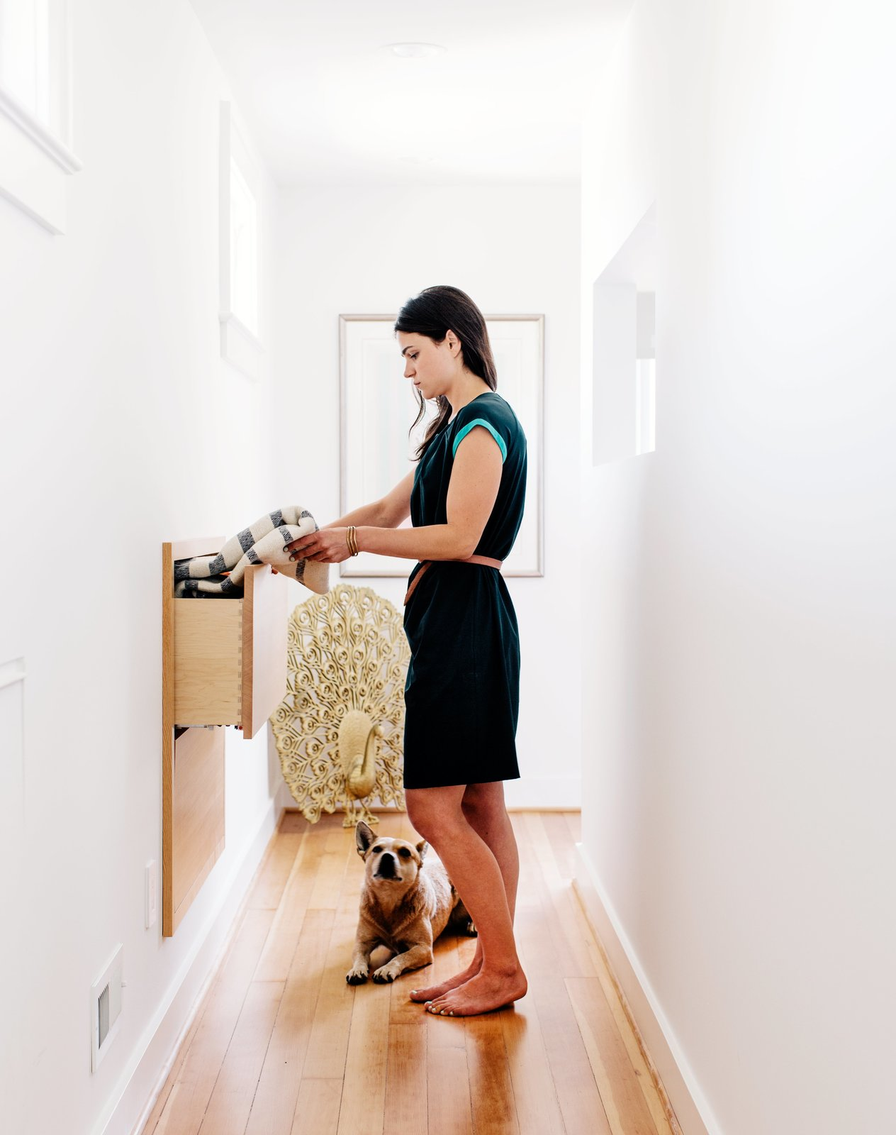 Storage Room and Cabinet Storage Type Sarah accesses a custom storage unit in the hallway, an addition that made use of a space behind the wall.  Photo 5 of 10 in A 1925 Portland Home Is a Rad Mashup of 20th-Century Styles