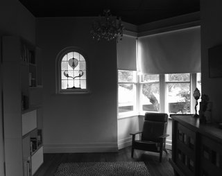 Nest Architects restored original details including bay windows, stained glass, and timber floors at the front of the house.