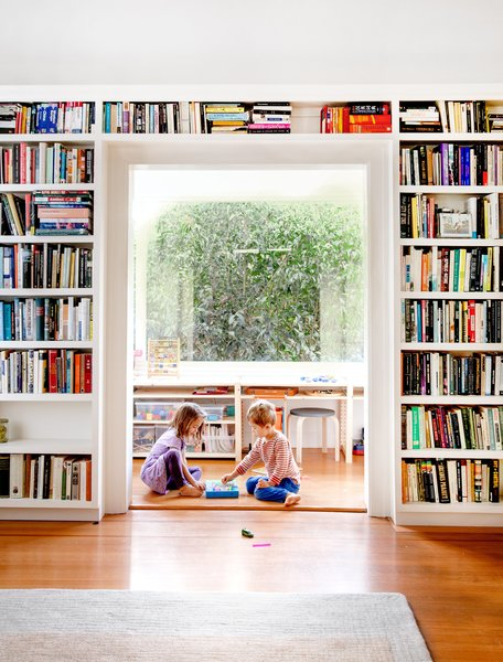 Living Room, Bookcase, Medium Hardwood Floor, Rug Floor, and Stools Toys are stashed in the play area. <span style=  Photo 6 of 15 in Check Back