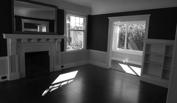 The adjoining living room, formerly the dining area, is kept free of playthings, TKTKTKTK  Photo 7 of 15 in Check Back