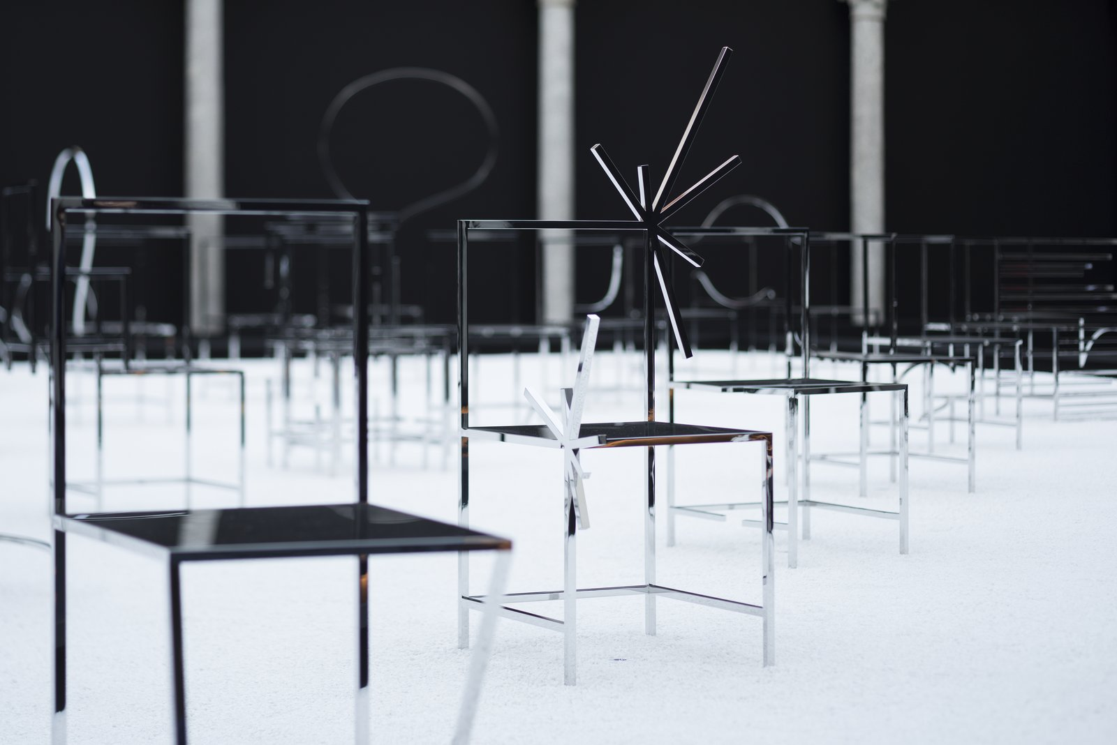 The chairs are completed with a mirrored finish.  Photo 6 of 7 in Pull Up a Chair: An Interview With Designer Oki Sato