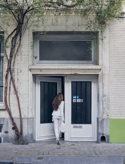 Venlet's wife and business partner, Evi Lippens, enters the home's unassuming street entrance in the city's Flemish Dansaert district.