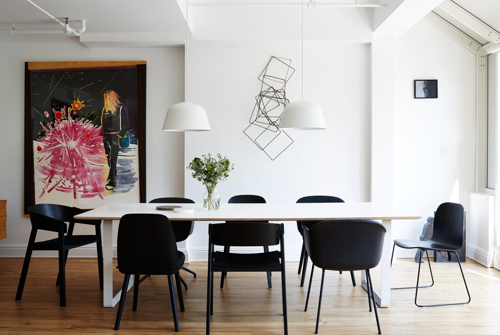 Dining Room, Chair, Table, and Pendant Lighting A series of black Muuto chairs—Fiber, Cover, Nerd, and Visu—surrounds a 70/70 table and white Ambit pendants, both by TAF Architects for Muuto.  Photo 6 of 14 in A Danish Design Kingpin Moves to NYC with a Shipping Container of Furniture in Tow