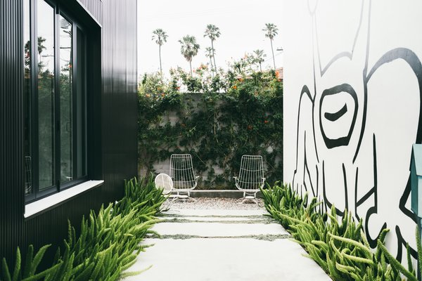 The Home Tours of Dwell on Design 2016 - Photo 1 of 8 - A giant mural by the artist Daniel Johnston dominates the outdoor garden of an art-filled home in Venice designed by Chris Rudin.