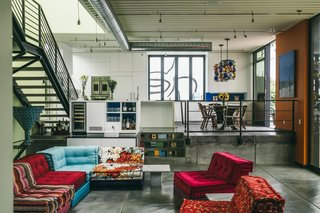 Inside, a colorful sectional softens the industrial vibe.