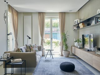 This Growing Family Maximizes Every Last Inch in Their 850-Square-Foot Apartment - Photo 7 of 14 - The Rod XL sofa by Piero Lissoni for Living Divani joins custom nesting tables, also designed by Di Stefano and Bongiorni and fabricated by Motta, in the refreshed living room.