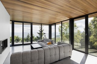 Located on the second floor, the living room hovers above the lower deck.