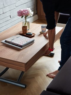 At His 350-Square-Foot Apartment, Small Space Champion Graham Hill Practices What He Preaches - Photo 3 of 15 - The Passo table by Resource Furniture features retractable legs and an expandable surface, which allow Graham to adjust its height and size.