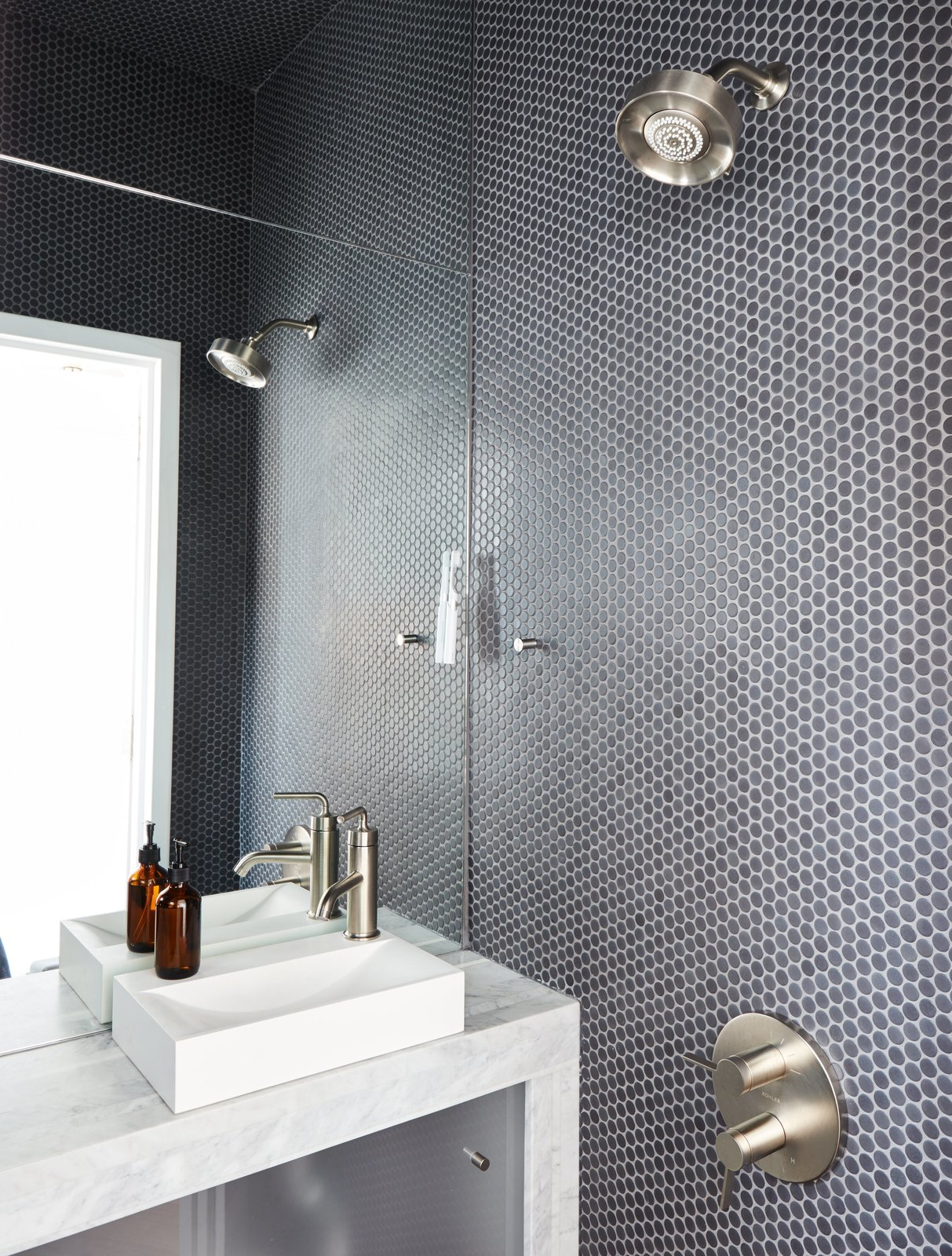 Bath Room, Open Shower, Mosaic Tile Wall, Marble Counter, and Vessel Sink The wet bathroom, clad in Savoy penny tile by Ann Sacks, helped optimize the home's petite footprint.  Photo 2 of 11 in Tile Talk: 5 Most Popular Shapes and How to Use Them from At His 350-Square-Foot Apartment, Small Space Champion Graham Hill Practices What He Preaches
