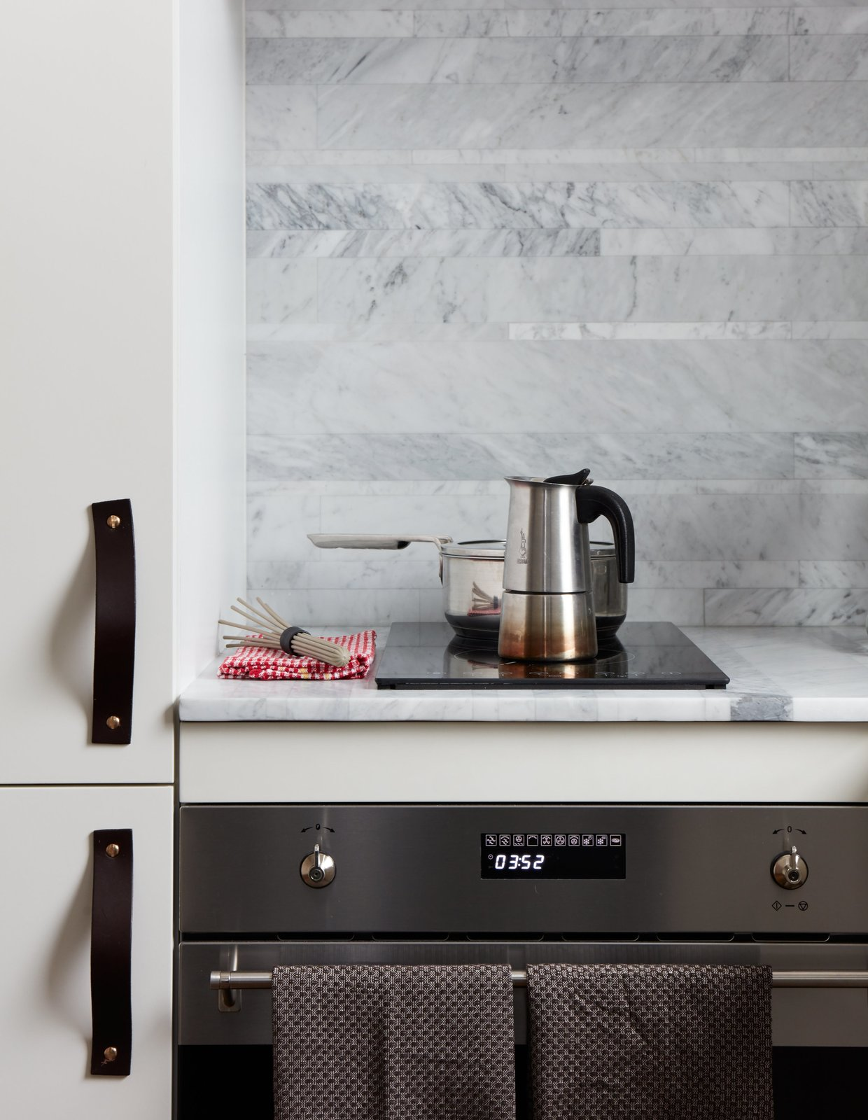 Kitchen, Range, and Cooktops The kitchen features a Smeg oven and Ramblewood induction range.  Photo 9 of 16 in At His 350-Square-Foot Apartment, Small Space Champion Graham Hill Practices What He Preaches