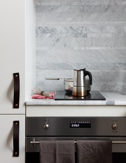 At His 350-Square-Foot Apartment, Small Space Champion Graham Hill Practices What He Preaches - Photo 8 of 15 - The kitchen features a Smeg oven and Ramblewood induction range.