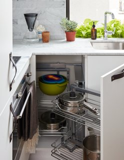 At His 350-Square-Foot Apartment, Small Space Champion Graham Hill Practices What He Preaches - Photo 9 of 15 - Clever cabinets from Resource Furniture save space for extra appliances, like a dishwasher. The counter is Bianco Carrara Lithoverde marble.