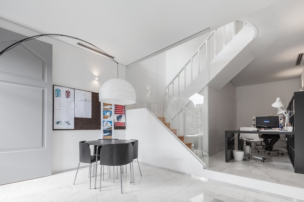 The firm used white materials throughout the renovation. The walls, ceilings, and woodwork are painted white. Portuguese Estremoz marble is featured on the ground floor.  Photo 2 of 7 in This Revived 19th-Century Home Keeps Its Character Even With a Minimalist Interior
