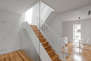 The narrow staircase captures light coming in from both the front and back sides of the home.