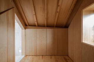 The majority of storage units are concealed by single materials. The closet on the top floor is covered in wood.