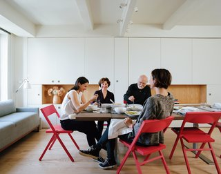 Among the Anderssons' wishes for the micro-dwelling was the ability to host a Thanksgiving feast. Garneau's solution delivers: Folding the pivot wall flush with the apartment's perimeter opens up the space for entertaining a sizable group.