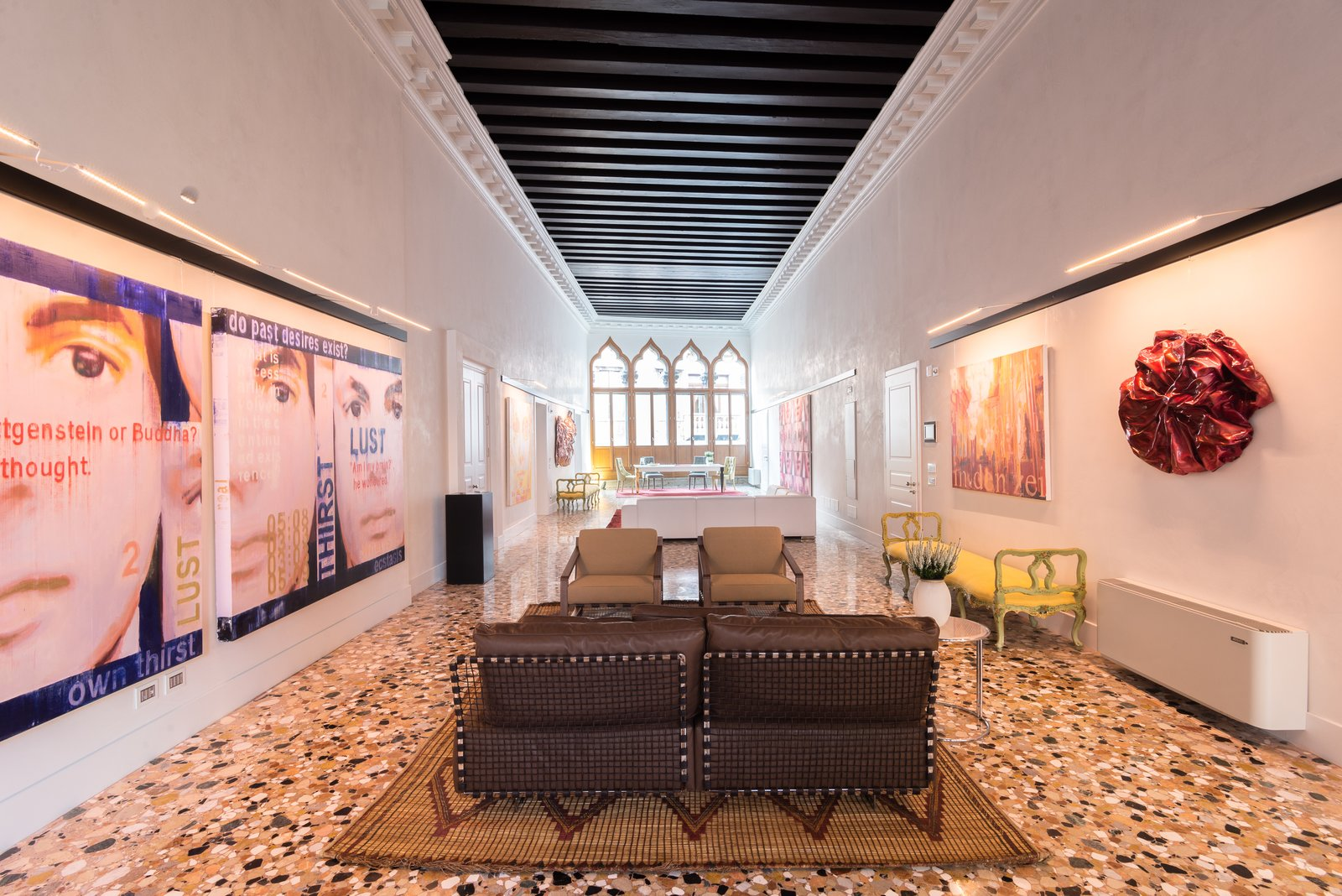 Living Room, Terrazzo Floor, Chair, Sofa, Bench, Table, and Accent Lighting The main living area of the home features Venetian terrazzo flooring and amble wall space.  Photo 3 of 5 in Act Like Italian Nobility in This Nearly $5 Million Apartment