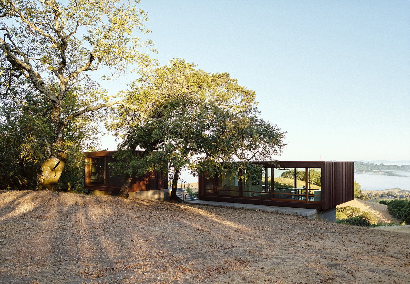 Exterior, Metal Roof Material, House Building Type, and Flat RoofLine Architects Geoffrey Warner and BJ Siegel collaborated to achieve this prefab home in the Sonoma Mountains. This was originally featured in Dwell 'Steel the Scene.'  Photo 1 of 5 in Steel the Scene