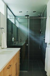 All three bathrooms feature Kohler fixtures, Caesarstone countertops, and slate ceramic tiles.