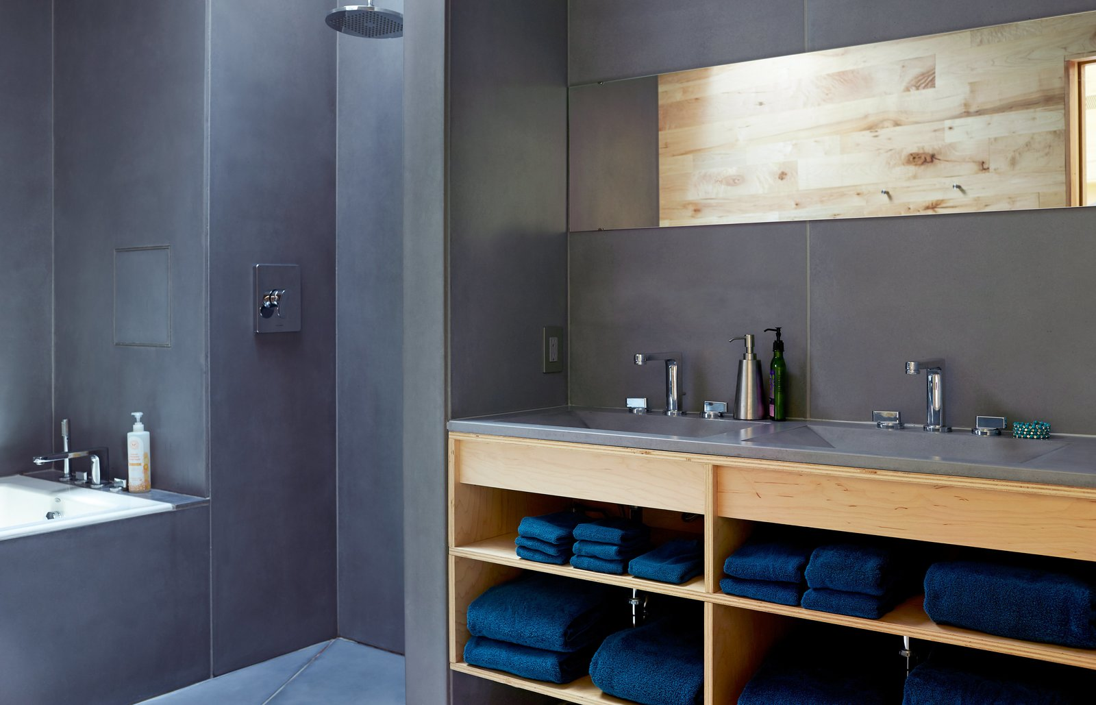Bath Room, Open Shower, Concrete Floor, and Concrete Counter HardLife Products manufactured the bathroom's custom concrete walls, floor slabs, and sink basins, which are paired with faucets by American Standard.  Photo 6 of 8 in Happy Trails