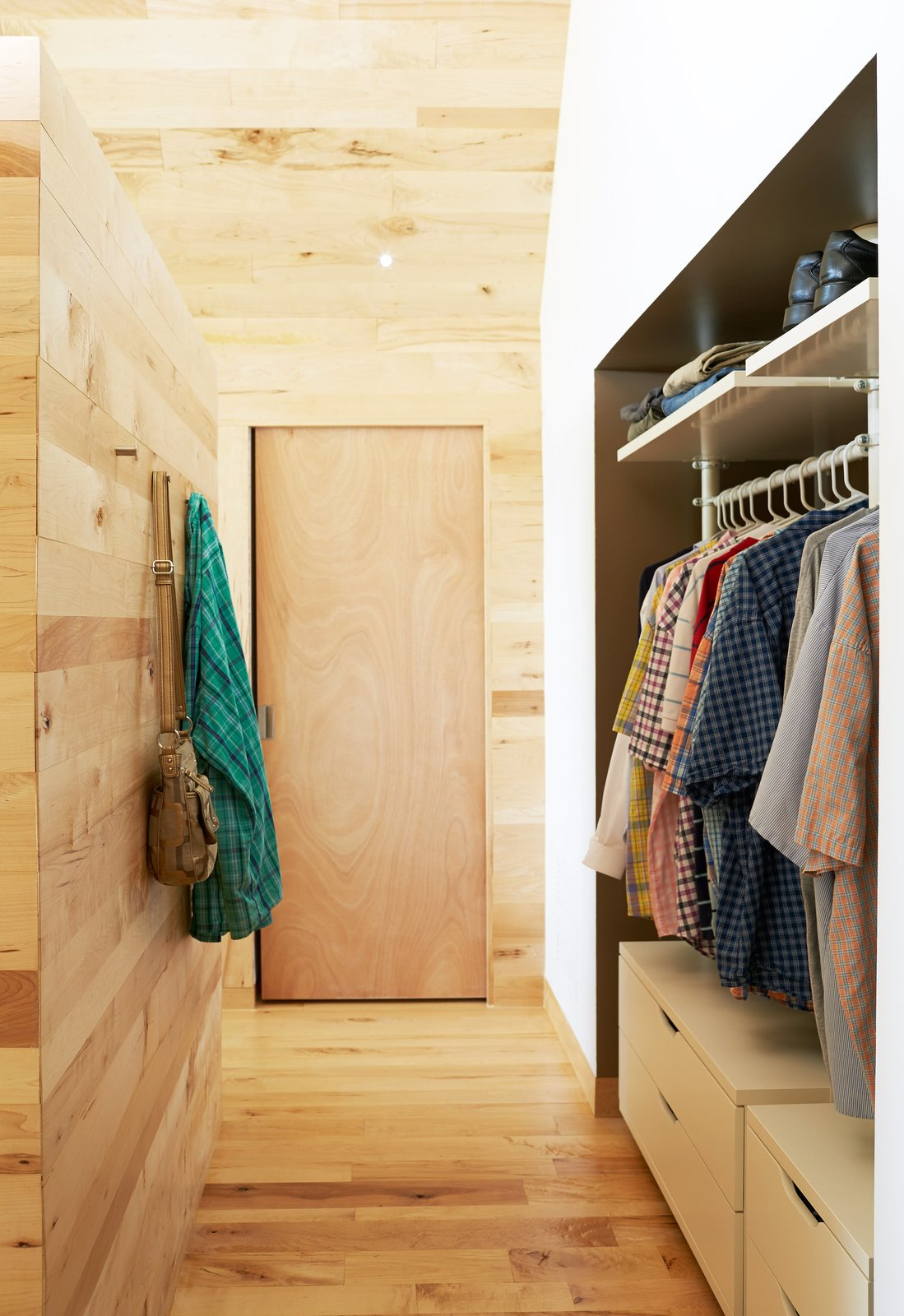 Storage Room and Closet Storage Type IKEA's Stolmen system holds the couple's clothes in the master bedroom. Solid core maple doors from Lowe's match the structure's interiors, which are lined in wood largely sourced from Union Church Millworks.  Photo 7 of 8 in Happy Trails