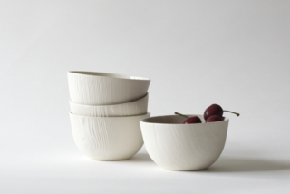 Woodgrain bowls, slipcast porcelain from hand-turned wood pieces, by Abigail Murray.