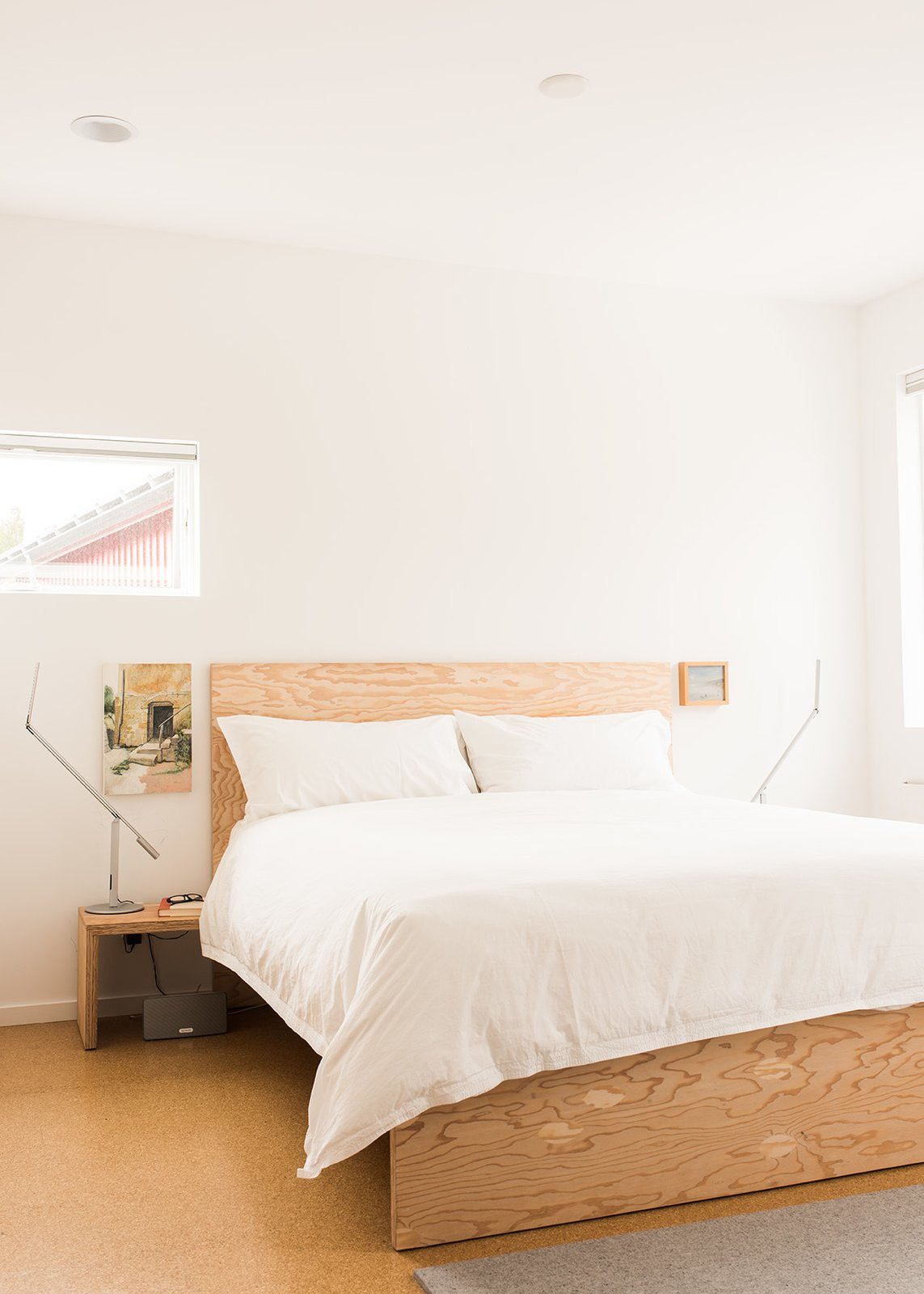 Bedroom, Bed, Night Stands, Recessed Lighting, Light Hardwood Floor, Lamps, and Table Lighting Davis used the same material to build furniture, including beds for his master bedroom.  Photo 7 of 15 in It Takes a Village