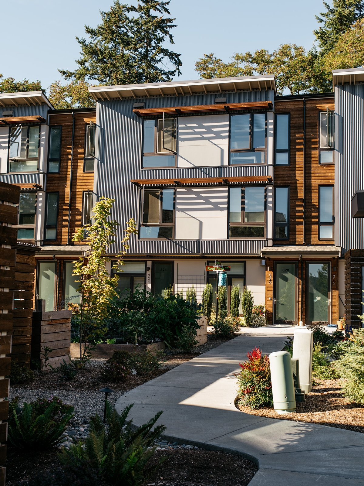 Exterior and House Building Type Phase one consists of 23 houses and two apartment buildings with 10 units each. The next two phases, The Grove and The Park, will offer a mix of town houses and condominium apartments. Some critics see these more conventional schemes as diluted versions of the original concept.  Photo 9 of 15 in It Takes a Village