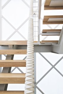 Designer and prefab proponent Jennifer Siegal's home is a site of continual experimentation. To create the custom leather-and-rope-wrapped handrail on the new staircase, she collaborated with Nicole Blue and Gabriela Schweizer, interns at her Office of Mobile Design.
