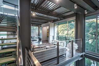 "Combining a prefab steel super-structure with concrete walls and insulated metal panels, Anthrazit House in Santa Barbara was designed by architects Pamela and Hector Magnus and built in collaboration with EcoSteel.""This wasn't a traditioImage by Hector Magnus.nal Santa Barbara site with large acreage,"" Hector says. ""It was small and steep."" Expansive windows on the second floor face a park. Image by Hector Magnus."